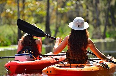 teenage girls kayaking